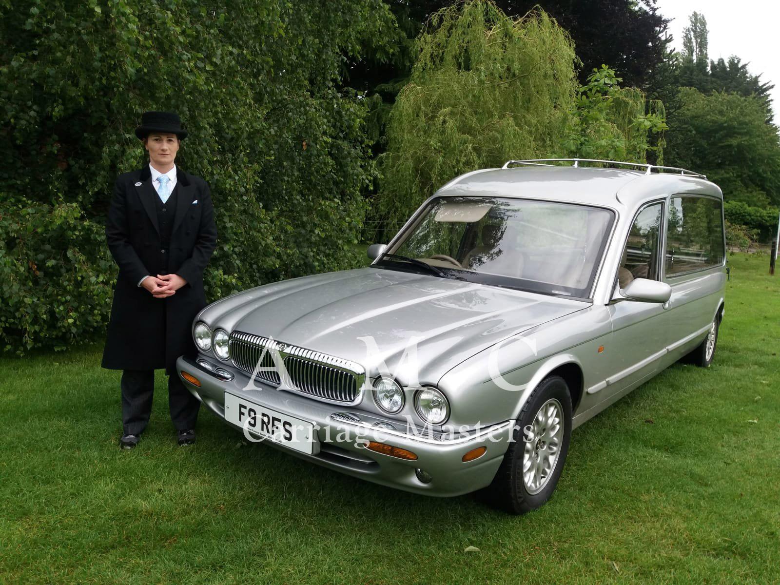 Silver Daimler/Jaguar XJ Hearse